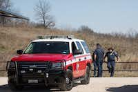 The Flower Mound Fire and Police Department investigate and search for a 2-year-old's missing father at Knob Hills Bike Trail on Tuesday in Roanoke. (Jeff Woo/DRC)