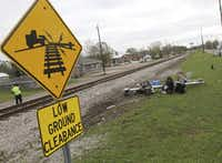 Debris from the railroad crossing signal litters the north side of the railroad tracks on Wednesday, March 8, 2017,  in Biloxi, Miss., where a CSX train hit a casino tour bus the day before.(John Fitzhugh/AP)