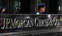 This file photo taken on July 13, 2012 shows a New York City Police officer  at the entrance to the JP Morgan Chase World Headquarters on Park Avenue in New York. (TIMOTHY A. CLARY/AFP/Getty Images