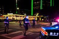 Dallas police walk through the intersection of Griffin and Jackson in downtown Dallas after there were reports of shots being fired during a Black Lives Matter rally on July 7, 2016. ((Smiley N. Pool/Staff Photographer))
