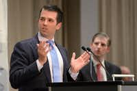 Donald Trump Jr. (left) and brother Eric are now running the president's businesses. (Jonathan Hayward/The Canadian Press)