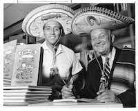 "Gilbert Martinez , left, son of founder of El Fenix restaurants and Dallas Morning News columnist Frank X. Tolbert, dressed in Mexican sombreros at an autographing party of Tolbert's newest book ""A Bowl of Red,"" a history of his favorite food, chili con carne.  Photo is stamped dated August 13, 1966. (Clint Grant/The Dallas Morning News)(staff photographer)"