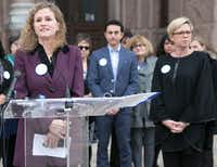 Rep. Donna Howard, D-Austin (left), shown at a December vaccination-policy event with Rep. Sarah Davis, R-Houston (right). (File Photo/Austin American-Statesman)