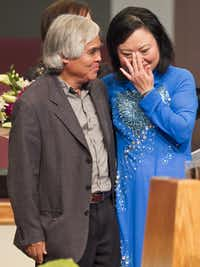 "In this Sunday, June 3, 2012 file photo, Associated Press staff photographer Nick Ut, left, meets Phan Thi Kim Phuc during a presentation at the Liberty Baptist Church in Newport Beach, Calif. ""That picture changed my life. It changed Kim's life,"" he says of the pair's chance meeting in a dusty Vietnamese village called Trang Bang.(Damian Dovarganes/AP)"