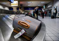 Luggage circles a baggage claim at Gate C on Friday, March 10, 2017 at DFW international Airport in Dallas. (Ashley Landis/The Dallas Morning News)(Staff Photographer)