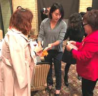 <br>South Korean golfer Ilhee Lee signs autographs during a reception at Las Colinas Country Club. (Deborah Fleck/Staff)<div><br></div>