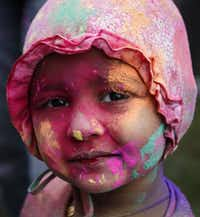 Colors from across the spectrum covered 2-year-old Aashi Amit Vaidya's face at a Holi festival in Irving. (File 2015)