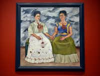 """<p><i>The Two Fridas,</i> a1939 oil on canvas, is part of the <i>Mexico 1900-1950: Diego Rivera, Frida Kahlo, Jose Clemente Orozco and the Avant-Garde </i>exhibitionat the Dallas Museum of Art. (<span style=""""font-size: 1em; background-color: transparent;"""">Ben Torres/Special Contributor)</span></p>"""