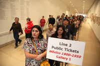"""Leslie Marrufozo (front) waits in line for the """"Mexico 1900-1950: Diego Rivera, Frida Kahlo, Jose Clemente Orozco, and the Avant-Garde"""" exhibit at the Dallas Museum of Art in Dallas on Tuesday, March 14, 2017.(Rose Baca/Staff Photographer)"""