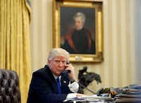 In this Saturday, Jan. 28, 2017 file photo, President Donald Trump speaks on the telephone with Australian Prime Minister Malcolm Turnbull in the Oval Office of the White House in Washington. (Alex Brandon / The Associated Press)