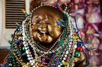 A laughing, cigarillo-chomping Buddha greets Wah Wah Chinese's customers.(Rose Baca/Staff Photographer)
