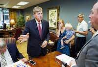 """Former Ku Klux Klan leader David Duke talks with qualifying officer Joe R. Salter, right, at the Louisiana Secretary of State's office in Baton Rouge, La., on Friday, July 22, 2016, after registering to run for the U.S. Senate, saying """"the climate of this country has moved in my direction."""" Duke's candidacy came one day after Donald Trump accepted the GOP nomination for president, and Duke said he's espoused principles for years that are similar to the themes Republicans are now supporting in Trump's campaign, on issues such as immigration and trade. Accompanying him are his daughter, Erika, center right, and grandson, Jack. (AP Photo/Max Becherer)(AP)"""