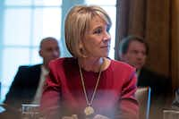 Education Secretary Betsy DeVos listened as President Donald Trump spoke during a Cabinet meeting in the White House in Washington, D.C., on Monday. (Andrew Harnik/The Associated Press)