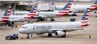 American Airlines planes in between Terminal A and C at DFW International Airport, on Monday, February 13, 2017. (Vernon Bryant/The Dallas Morning News)(Staff Photographer)