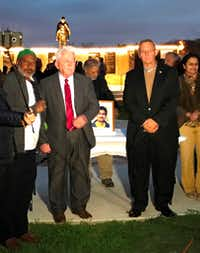 From left: Abdel Elhassan, Irving City Council member Oscar Ward and mayoral candidate Rick Stopfer attended the candlelight vigil for Srini Kuchibhotla at Gandhi Memorial Plaza in Irving on March 4.((Debbie Fleck/The Dallas Morning News))