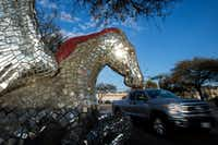 A truck passes a mirrored Pegasus statue in the northeast corner of the Preston Royal shopping center on Wednesday, March 8, 2017 in Dallas. (Jeffrey McWhorter/Special Contributor)Special Contributor
