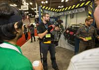 Gavin Barnes, a lead engineer at Lockheed Martin shows the Fortis exoskeleton at SXSW. (Thao Nguyen/Special Contributor)