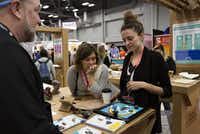 Julie Lee and her coworker Karla Courtney visited one of the low tech booths at SXSW. It explored the uses of paper. Thao Nguyen/Special Contributor