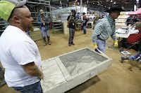 Western diamondback rattlesnakes arrive for weighing at Nolan County Coliseum for the Sweetwater Rattlesnake Roundup . (Nathan Hunsinger/The Dallas Morning News)