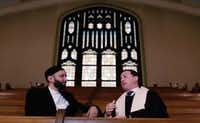 Imam Omar Suleiman and Rev. Andy Stoker of First United Methodist Church were shown in an ISIS video that appeared online making threats against him and other Western imams. (no credit)