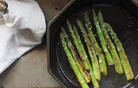 Coat asparagus evenly with butter by gently shaking the pan.((Coryanne Ettiene))