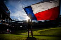Texas Rangers Six Shooter Jaime Thatcher waves a Texas flag in the outfield before their game against the Houston Astros on Wednesday, June 8, 2016 at Globe Life Park in Arlington, Texas. (Ashley Landis/The Dallas Morning News) ORG XMIT: DMN1606081913174880(Staff Photographer)