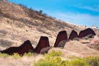 More than 700 companies have expressed in interest in helping build the border wall, which could replace border fencing that's already in place. (Jim Watson/Agence France-Presse)