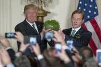President Donald Trump, left, and Irish Prime Minister Enda Kenny, right, hold up a bowl of Irish shamrocks during a St. Patrick's Day reception in the East Room of the White House in Washington, Thursday, March 16, 2017.(Andrew Harnik/AP)
