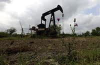 In this Friday, May 13, 2016, photo, a pump jack sits idle on a South Texas ranch near Bigfoot, Texas. (AP Photo/Eric Gay)(AP)