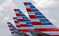 This July 17, 2015, file photo shows the tails of four American Airlines passenger planes parked at Miami International Airport, in Miami. (AP Photo/Alan Diaz, File)(AP)