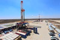 """<p><span style=""""font-size: 1em; background-color: transparent;"""">A Patterson-UTI drilling rigs that uses hydraulic feet to """"walk"""" from one drill site to another. This one operates in West Texas. (Courtesy: Patterson-UTI Drilling Company.</span></p>"""