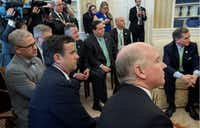 <p></p><p>Texas Reps. John Ratcliffe (left in foreground) and Blake Farenthold (seated in back row, fourth from left) meet with President Donald Trump in the Oval Office along with other members of the Republican Study Committee to talk about the proposed American Health Care Act. (Stephen Crowley/The New York Times)</p><p></p>