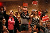 "People shout to ""vote him out"" during a town hall meeting with Rep. Pete Sessions, R-Dallas, in the auditorium of Richardson High School on Saturday. (Vernon Bryant/The Dallas Morning News)Staff Photographer"