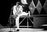 In this Oct. 17, 1986 file photo, Chuck Berry performs during a concert celebration for his 60th birthday at the Fox Theatre in St. Louis, Mo. (AP Photo/James A. Finley)