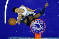 Philadelphia 76ers' Timothe Luwawu-Cabarrot top, goes up for a shot against Dallas Mavericks' Nerlens Noel during the first half of an NBA basketball game, Friday, March 17, 2017, in Philadelphia. (Matt Slocum/Associated Press)