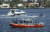U.S. Coast Guard patrol, watch Lake Worth Lagoon as President Donald Trump returns to his Mar-a-Lago estate in Palm Beach, Fla., Sunday, March 19, 2017. Trump and his family are spending their weekend at his resort in Palm Beach, Florida.(Manuel Balce Ceneta/AP)