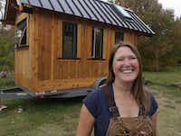 B.A. Norrgard photographed Thursday November 21, 2013 with the tiny house she is building in Garland. The house is under 150 square feet.((Ron Baselice/Staff Photographer))