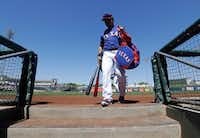 The Rangers' Shin-Soo Choo entered the dugout before Sunday's spring training game against Seattle in Surprise, Ariz. (Darron Cummings/The Associated Press)