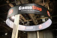 FILE - This Aug. 28, 2013, file photo shows signage at GameStop Vegas 2013, in Las Vegas. GameStop is diving into the video game publishing business. The retailer best known for selling games announced plans Monday, April 18, 2016, to launch a new division called GameTrust that will help distribute and market them. (Photo by Al Powers/Invision/AP, File)(Powers Imagery/Invision/AP)