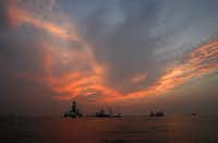 "<p>Vessels assist in the drilling of the Deepwater Horizon relief  near the coast of Louisiana at sunset in <span style=""font-size: 1em; background-color: transparent;"">September  2010.</span></p>(<p><span style=""font-size: 1em; background-color: transparent;"">(DMN file/AP Photo/Patrick Semansky)</span></p>)"