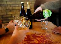 "<p><span style=""font-size: 1em; background-color: transparent;"">Beer lovers at the Bearded Lady in Fort Worth share a bomber, a large-format bottle of beer. (Tom Fox/The Dallas Morning News)</span></p>"