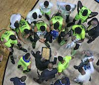 <p>The Baylor team listens intently as head coach Scott Drew draws up a play during a timeout in the first half during the USC Trojans vs. the Baylor Bears NCAA men's basketball game at the BOK Center in Tulsa on Sunday. (Louis DeLuca/The Dallas Morning News)<br></p><p></p>(Louis DeLuca/Staff Photographer)
