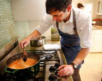 "<p><span style=""font-size: 1em; background-color: transparent;"">Julian Barsotti, chef-owner of Nonna, Carbone's Fine Food & Wine and Sprezza, makes Bolognese sauce in his Highland Park home. The sauce is a component of his 21-layer timpano. (Tom Fox/Staff Photographer)</span><br></p><p></p>"