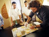 Travis Hughes (right), a cheese specialist at Regalis Texas, assembles a platter of cheeses for Ehlert (left) and sous-chef David Gomez to consider for the French Room. (Tom Fox/The Dallas Morning News)