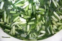 Wild onions are boiled before being sauteed with other ingredients.(Rose Baca/Staff Photographer)
