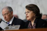 The Senate Judiciary Committee's ranking member, Dianne Feinstein, D-Calif., accompanied by the committee's chairman, Charles Grassley, R-Iowa, spoke on Capitol Hill in Washington on Tuesday during the committee's confirmation hearing for Supreme Court justice nominee Neil Gorsuch. (Pablo Martinez Monsivais/The Associated Press)