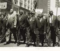 Jackie Robinson (middle with left hand in pocket) was among 35,000 demonstrators for civil rights on the eve of the 1964 Republican National Convention in San Francisco.