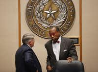 Commissioner Mike Cantrell (left) speaks with John Wiley Price, his colleague on the Commissioners Court, in October 2014. Cantrell testified in Price's federal corruption trial that he would have reported Price's alleged misconduct to the DA had he known. (Staff Photo/The Dallas Morning News)