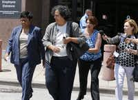 Kathy Nealy (left) leaves the federal courthouse in Dallas after being indicted on bribery charges in connection with the John Wiley Price corruption case. (Staff Photo/The Dallas Morning News)