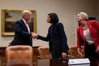 President Trump greets Seema Verma, administrator of the Centers for Medicare and Medicaid Services. At right is Texas state Sen. Dawn Buckingham.(AFP/Getty Images/Jim Watson)